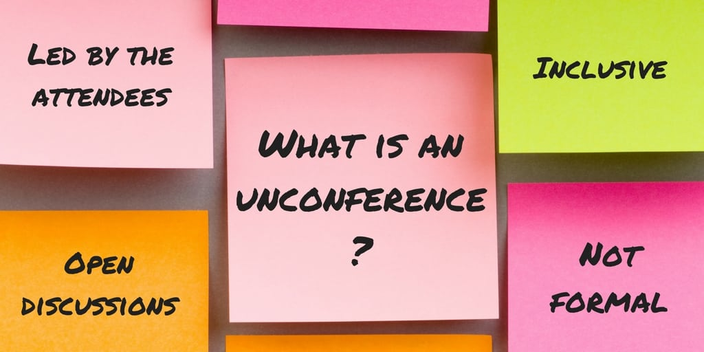 A pink post-it note with 'what is an unconference?' written on it in black text