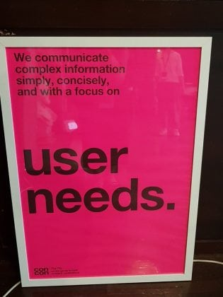 "Poster from 2018 cross government content design conference that says ""we communicate complex information simply, concisely and with a focus on user needs."