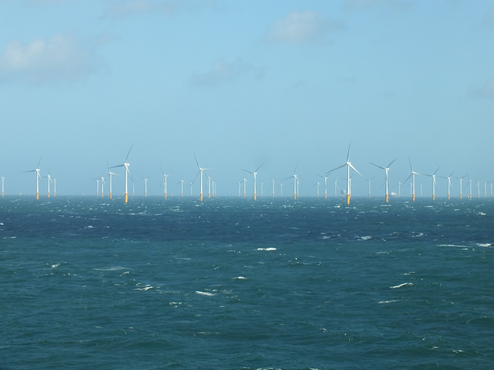 Picture showing an array of wind turbines in the sea. Crown copyright