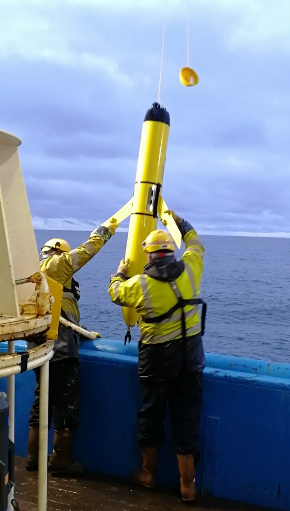 Crew recovering Autonomous underwater vehicle (AUV)