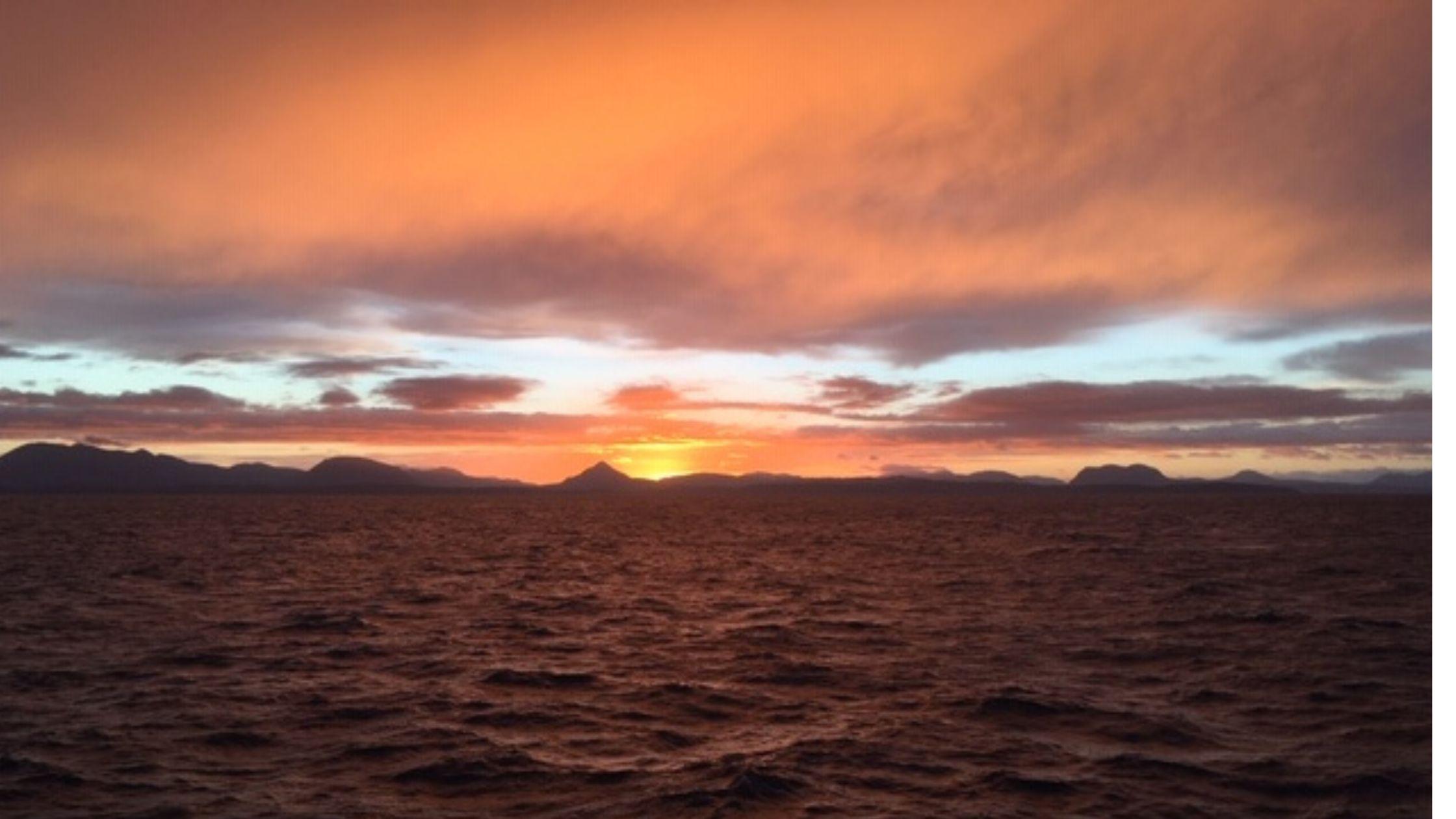 Sun setting at sea