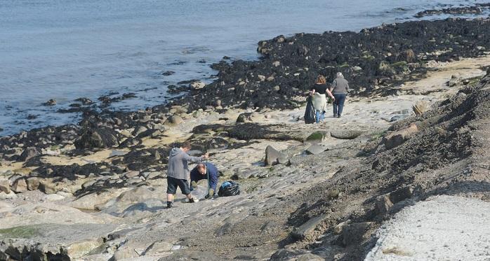 Litter picking at Aberdeen beach. Crown copyright