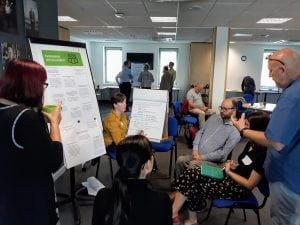 People discuss ideas and possible commitments on participation and improving consultation