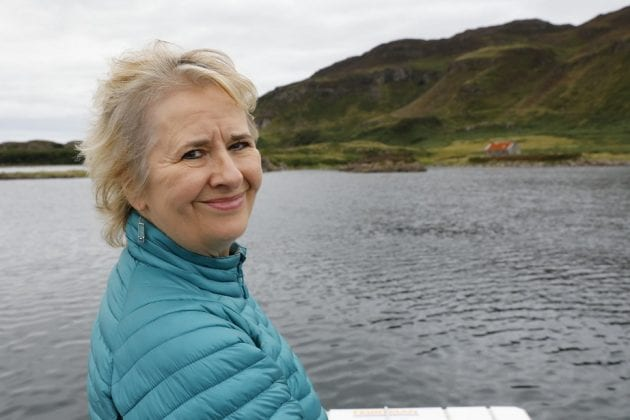 An image of Roseanna Cunningham by a lake with hills in the background.